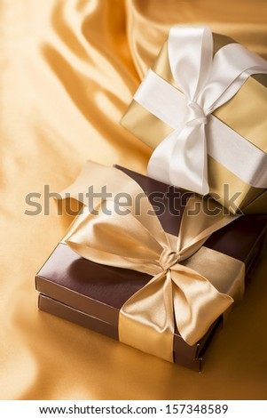 brown box with candies and golden tape