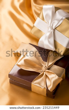 brown boxes with candies and golden tape, coffee grains