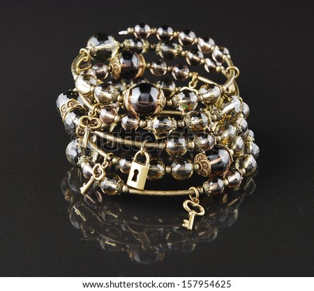Brown bracelet on black background - stock photo