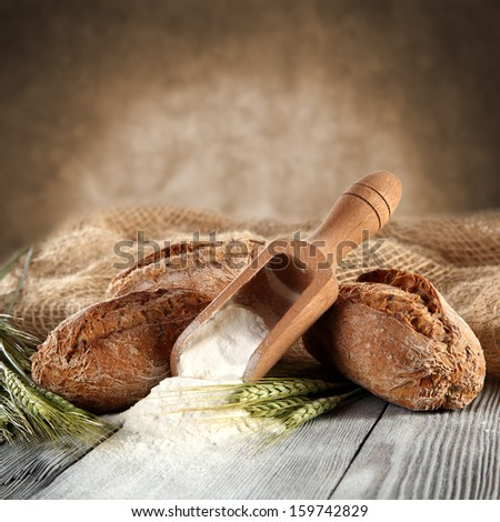 brown bread and flour  - stock photo