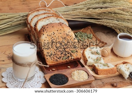 Brown bread with whole grain cereals of sliced and milk - stock photo