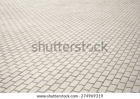 Brown brick stone street road. Light sidewalk, pavement texture - stock photo