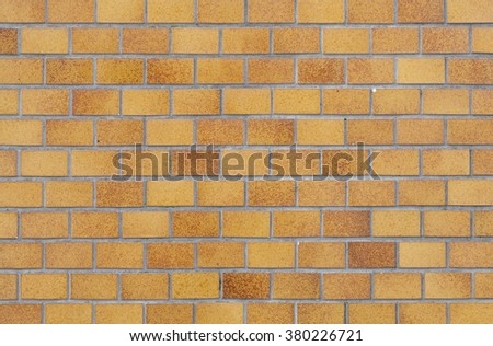 Brown brick stone wall seamless background and texture - stock photo