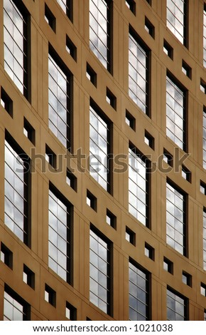 brown building with windows upright - stock photo
