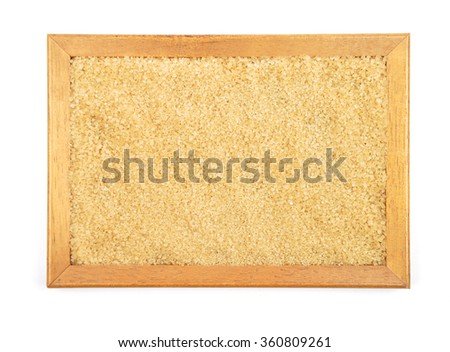 Brown cane sugar in frame - stock photo