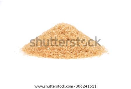Brown cane sugar on white - stock photo