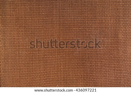 Brown canvas material textured background. - stock photo