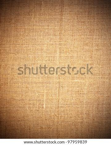 brown canvas texture background with dark vignette - stock photo