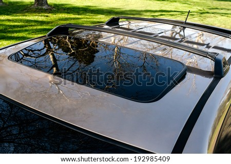 Brown  car SUV sunroof, hatch close-up - stock photo