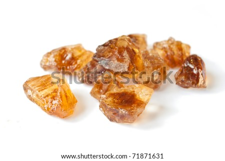 Brown caramelized sugar on white background - stock photo