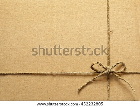 Brown cardboard box tied with rope