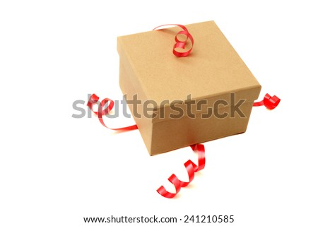 Brown cardboard box with red ribbon isolated on white. Studio shot. - stock photo