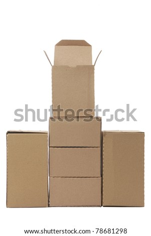 Brown cardboard boxes arranged in stack on white background - stock photo