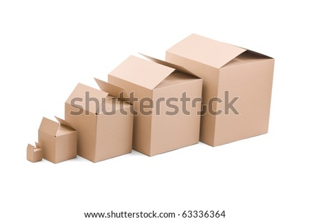 Brown cardboard boxes arranged on white background - stock photo
