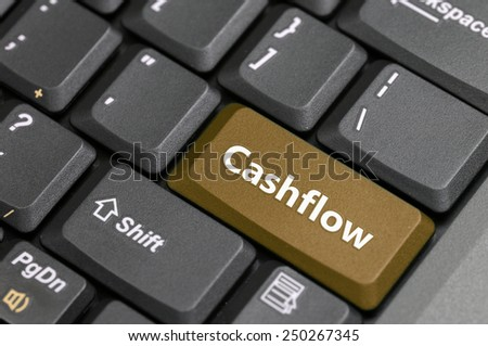 Brown cashflow key on keyboard - stock photo
