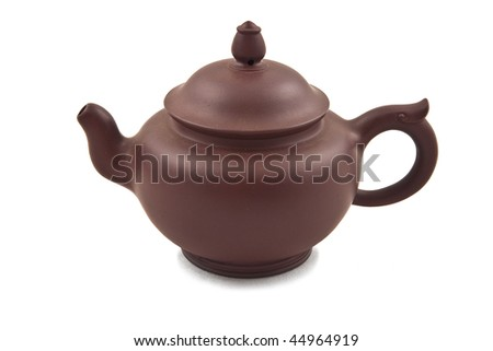 brown ceramic teapot with cover isolated on white