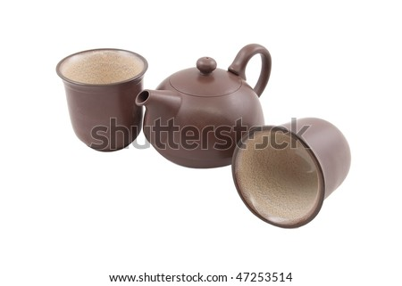 brown ceramic teapot with two cups isolated on white