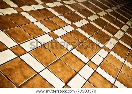 brown ceramic tiled floor background - stock photo