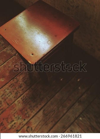 Brown chair on the floor - stock photo