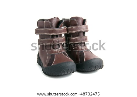 brown child boots white isolated