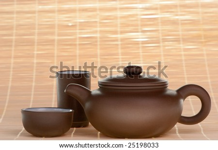 Brown chinese ceramic teapot with cups - stock photo