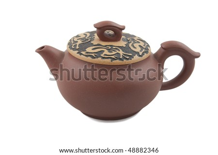brown chinese teapot with dragon ornament on lid isolated on white