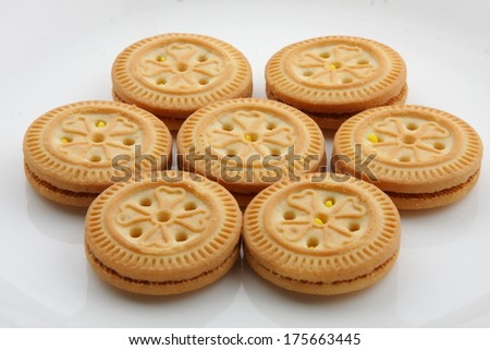 brown chocolate sandwich biscuits with cream filling - stock photo