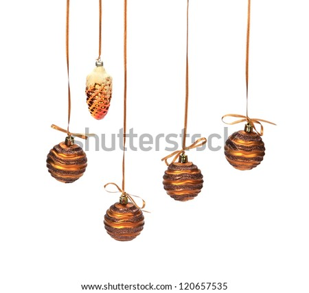 brown christmas baubles on white - stock photo