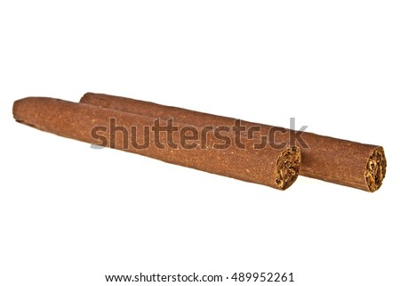 Brown cigars on a white background