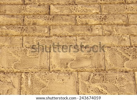 Brown cladding tiles imitating stones in sunny day  - stock photo