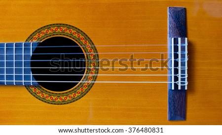 Brown classic guitar string closeup - stock photo