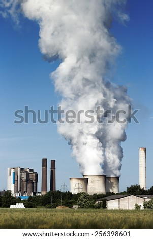 Brown coal fuel power station emission - stock photo