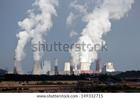 Brown coal power plant emission - stock photo