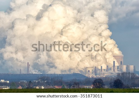 Brown coal power plant emission. - stock photo