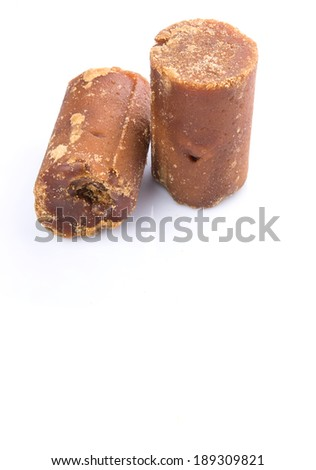 Brown coconut sugar over white background