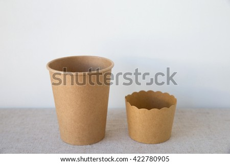 brown coffee and cupcake paper cups - stock photo