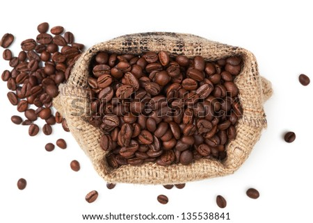 Brown coffee beans in sack isolated on white background, top view. Culinary coffee background.