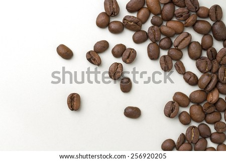 Brown coffee beans isolated on white background - stock photo