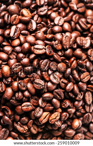 Brown coffee beans. Roasted coffee beans for background and texture. Closeup, macro. - stock photo