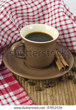 brown coffee cups with coffee beans and cinnamon - stock photo