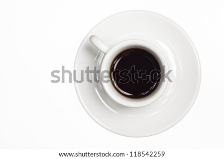 Brown coffee poured into white modern cup with saucer, isolated background