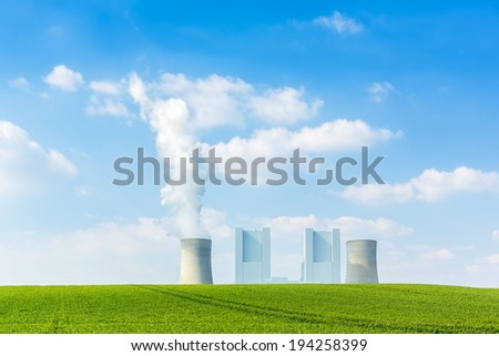 brown cole power station with cooling tower on a cornfield - stock photo