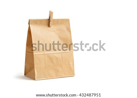 Brown color recycled paper bag with wooden peg isolated on white, recyclable paper bag for food concept - stock photo