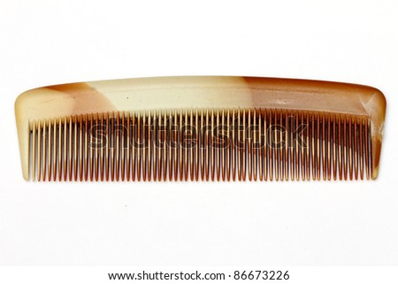 brown comb on white background - stock photo