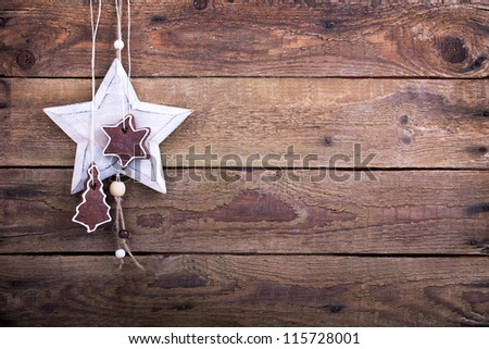 brown cookies with a white wooden star on a old rustic wooden board, christmas decoration - stock photo