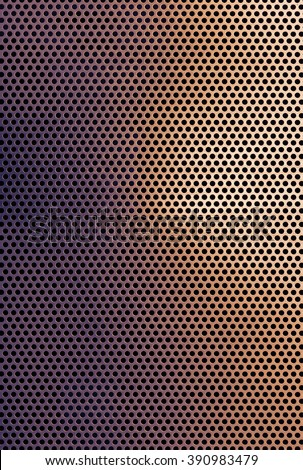 Brown copper colored metal grid background texture with repeat perforated round holes in a full frame geometric pattern with highlight and shadow detail
