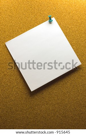 Brown cork board with pinned paper note - stock photo