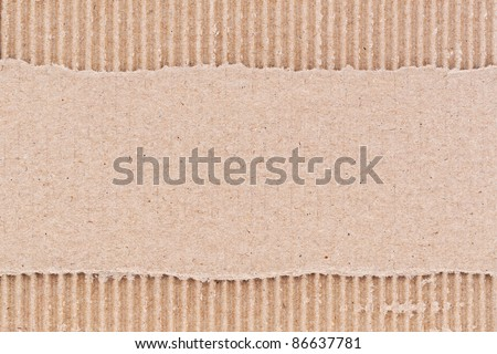 Brown corrugated cardboard paper background. - stock photo
