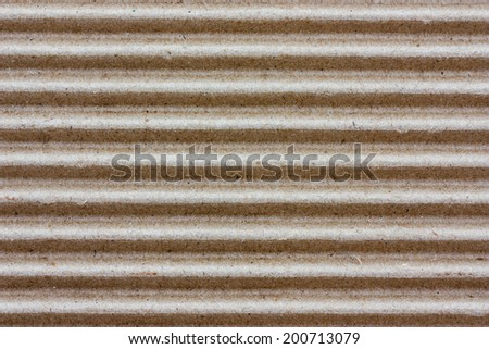 Brown corrugated cardboard used for the background. - stock photo