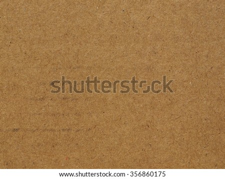 Brown corrugated cardboard useful as a background - stock photo